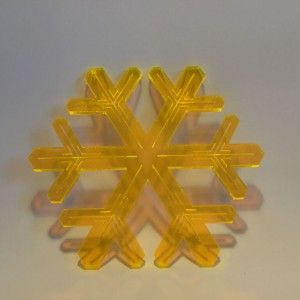 Orange lasercut plexiglass ornaments. Designed and produced in Copenhagen, Denmark.