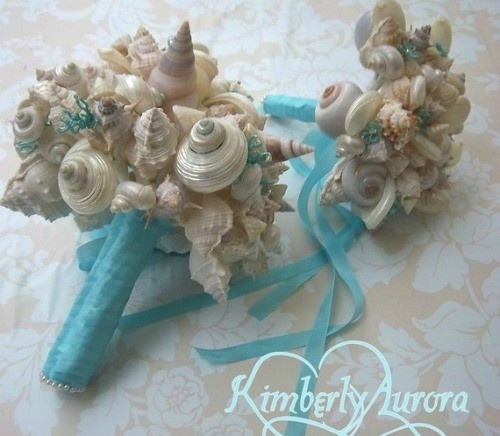 I really like the blue ribbon that ties everything together.  It's a good way to get blue into it.    Go for a completely unique look with custom made seashell beach wedding bouquets that you can just pack away in your suitcase and then keep forever!