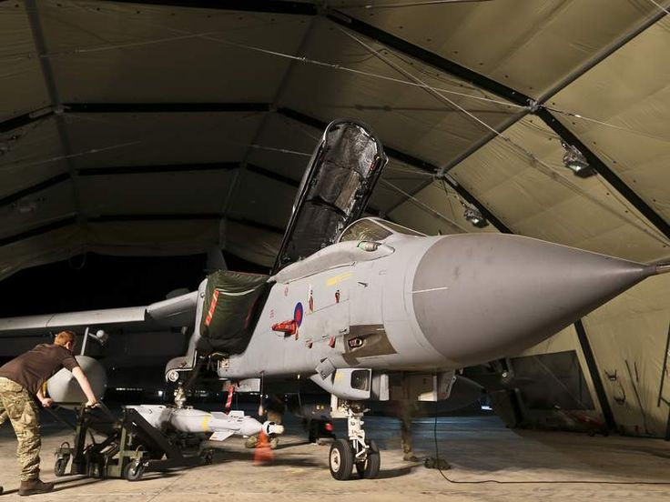 RAF Panavia Tornado GR4 attack aircraft at RAF Akrotiri Cyprus being armed with the Paveway IV Laser Guided Bomb. Pic: MoD.