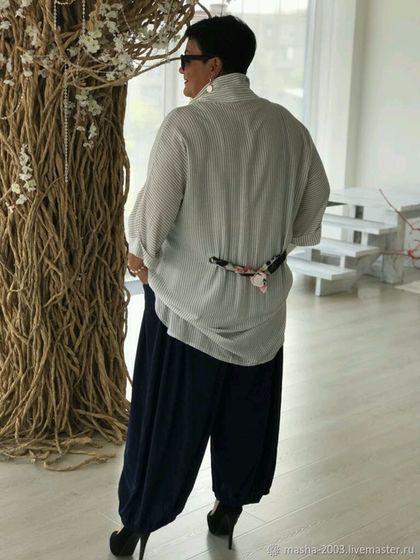 Купить или заказать Блуза в интернет-магазине на Ярмарке Мастеров. Блуза белая, удлинённая ,в мелкую полоску. Декорированна цветной тесьмой по карману и сзади на уровне талии. Состав ткани: вискоза. Очень нежная и мягенькая. Размеры 52-64. Цена 4800 руб. Брюки темно-синие на широкой резинке. Фасон юбки-брюк, в бёдрах заложены складочки под карманами, визуально уменьшают бёдра. Состав ткани: хлопок, эластан. Очень комфортные в носке. Размеры 52-66. Цена 4000 руб.