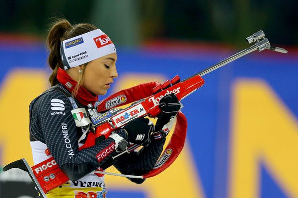 Dorothea Wierer of Italy shoots during the JOKA Biathlon World Team Challenge 2016 at Veltins-Arena on December 28, 2016 in Gelsenkirchen, Germany.