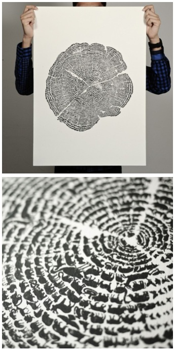"""A unique tree of life design by Gary, Aaron & Khairul from Degree in the shape of a tree trunk; a closer look shows that each """"ring"""" is composed of different animals."""