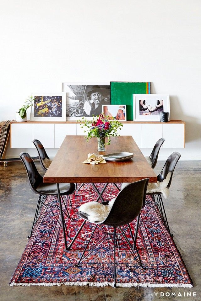 Dining space with a vintage rugs, polished concrete floor, and a modern dining set