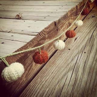 Crocheted pumpkin garland for Halloween