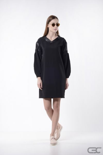 http://cbcdesign.ro/en/shop/rochie-night-sky/  Midi dress with oversized sleeves from black suiting fabric, faux-kimono collar and sleeve head from black eco leather. Through styling, the dress can be transformed in different styles: office accessorized with nude stilettos, grunge with some colored boots or romantic with a delicate vest. The wearing options are unlimited when it comes to a LBD.