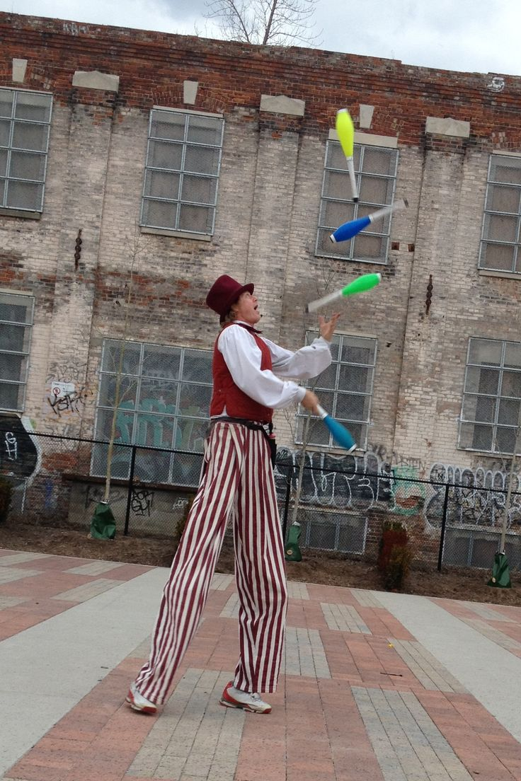 Dress rehearsal and spring training for the stilts-man, juggler, high output deluxe balloon sculptor on market square, during spring 2015.