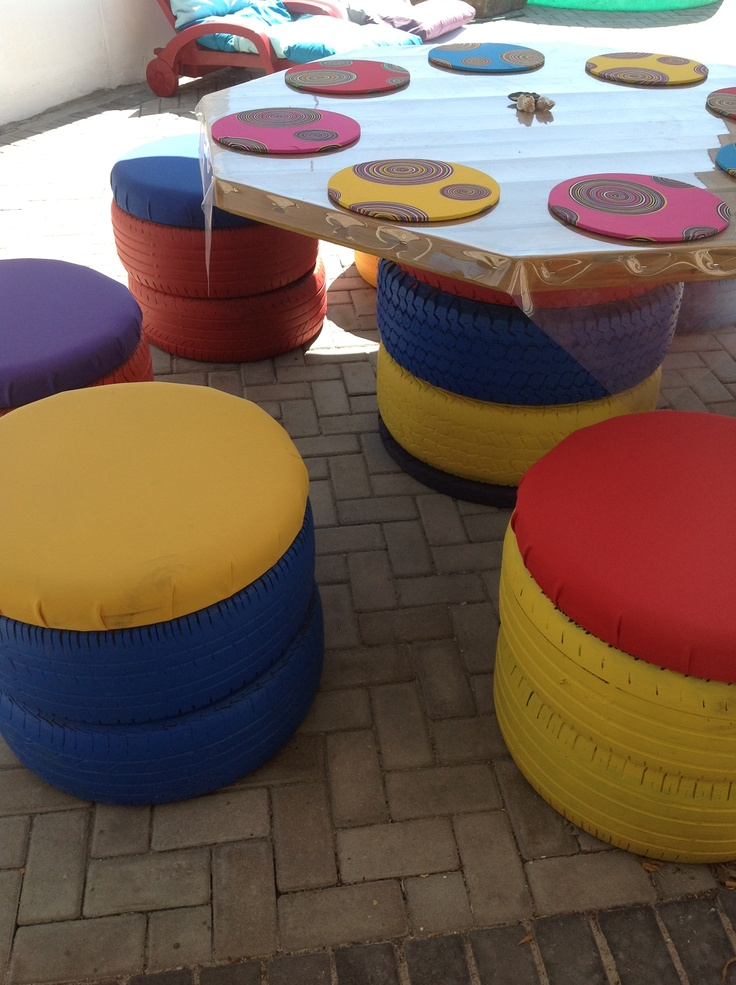 Outdoor furniture made from old tyres. The table top is made from old decking wood.