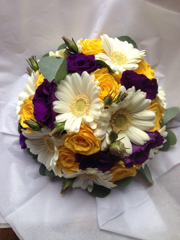 Yellow roses, White germini, purple lisianthus and eucalyptus