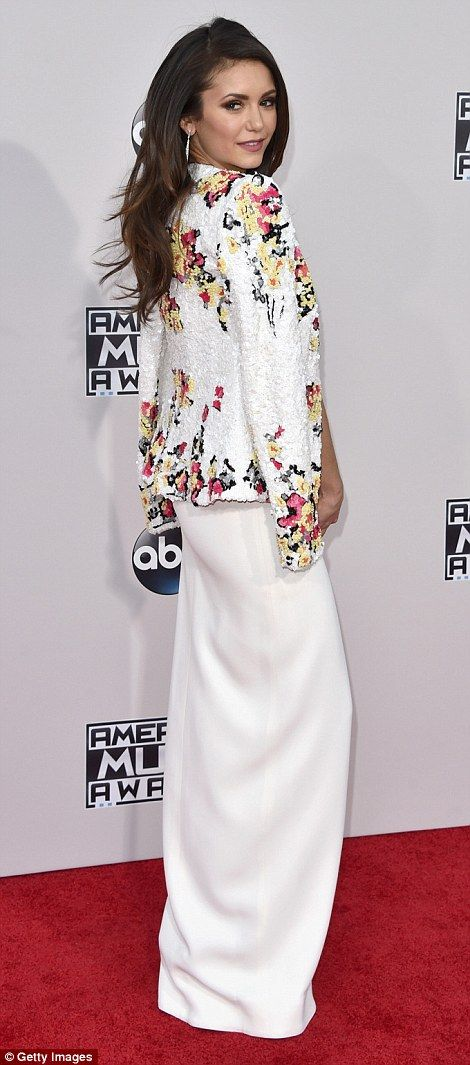 Simply stylish: Actress Nina Dobrev donned a gorgeous cream outfit with floral motif...