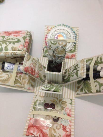 caixa em cartonagem para costura,contendo um kit com:agulhas,linhas,alfinetes,passador de linha ,alfinetes de gancho,tesourinha e fita métrica. R$ 70,00