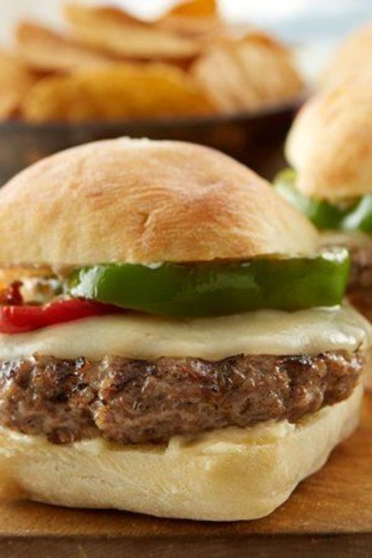 "Meatballs aren't just for spaghetti! Use them as the ""patty"" in these garlicky, cheesy burgers. The homemade Parmesan aioli and a layer of gooey provolone cheese take them over the top. For toasty buns, brush the ciabatta bread with a little olive oil and toss them on the grill for two to three minutes while the burgers are finishing up."