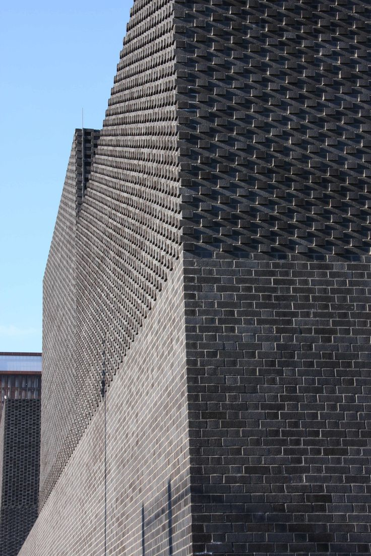 A detail from the award winning sub-station showing the subtle play of light along the black Ibstock brick wall