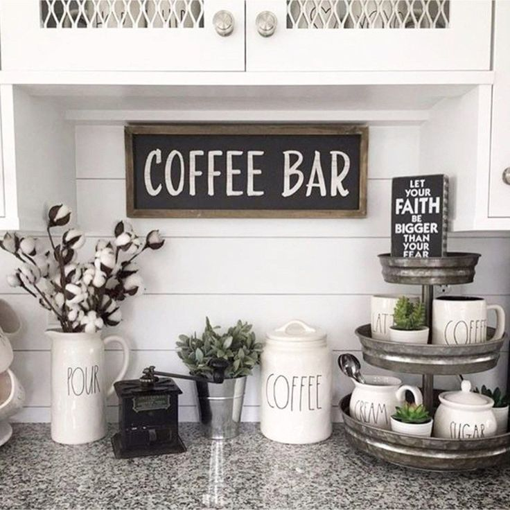 Beautiful coffee bar set up ideas on this kitchen counter. Love the Rae Dunn coffee mugs and canisters and that 3-tier organizer is a great tounch