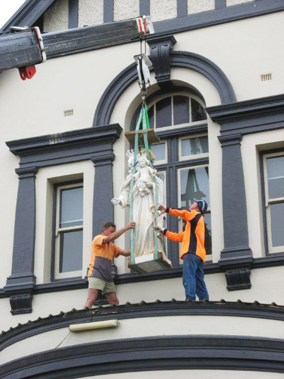 Installing the Virgin Mary statue