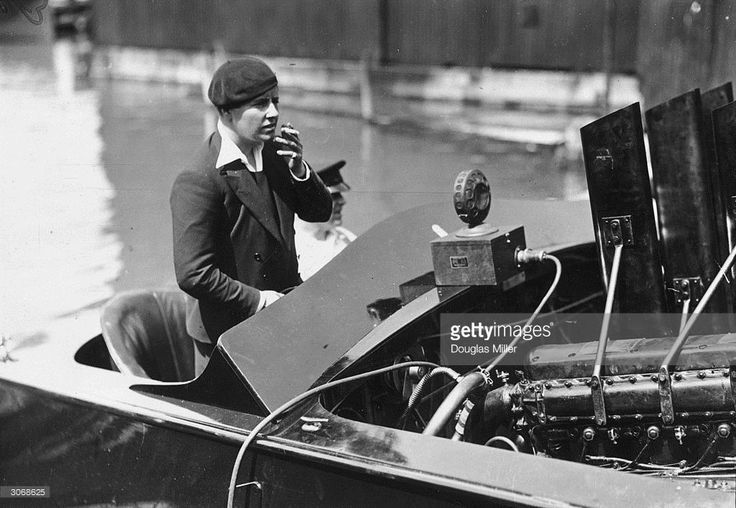British speedboat racer Betty Carstairs behind the wheel of an Estelle IV speedboat at Cowes, on the Isle of Wight. 1930.