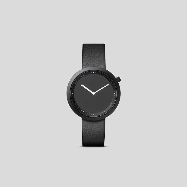 BLACK STEEL ON BLACK ITALIAN LEATHER.    Clean, classic and contemporary, Facette pays homage to the iconic, circular watch shape while incorporating distinct, forward-thinking design details.