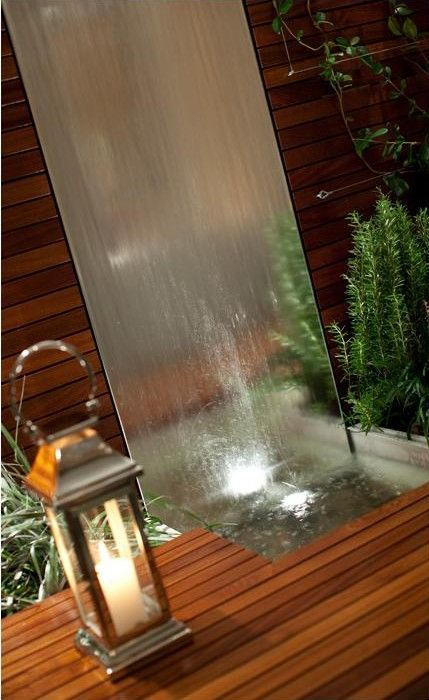 This example shows how the water wall (with both mirror feature and water element) would look at night to help make the backyard an idyllic place for the family to relax in, especially during summer nights.