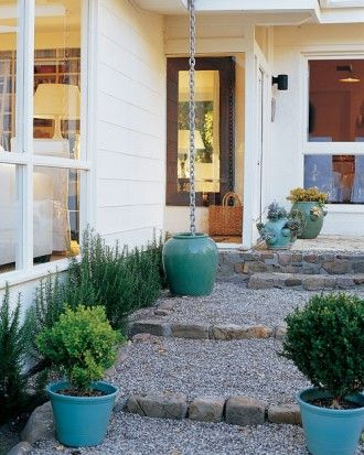 Boxwood, rosemary, and gravel steps = Provencal-style welcome