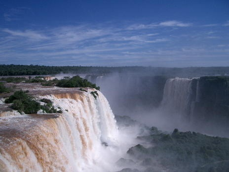 Iguazu National Park straddles the border between Argentina and Brazil. Some 262 feet (80 meters) high and 1.8 miles (3 km) wide, the falls are made up of many cascades that generate vast sprays of water and produce one of the most spectacular waterfalls in the world.
