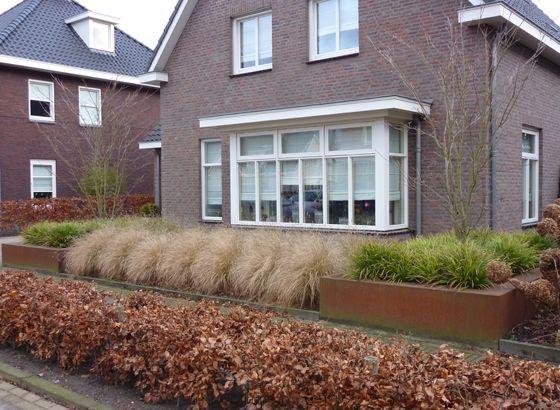 Moderne voortuin met cortenstaal Bergeijk   Tilburgs Tuinen Bergeijk - Advies, ontwerp, aanleg, onderhoud en renovatie