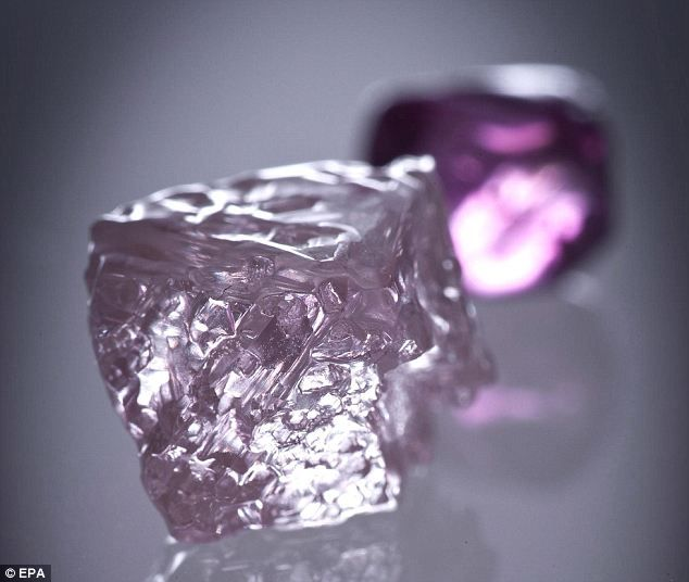 Shining example: The Argyle Pink Jubilee diamond with a smaller Argyle pink diamond in the background