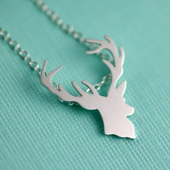 """Fun, Rustic and Darling. This intricate Deer Head SIlhouette Necklace is the perfect amount of woodland whimsy and sophistication.A detailed Deer Head silhouette is hand pierced/sawed/filed sterling silver and then given a bright satin finish. The pendant measures just about 3/4"""" from top to bottom and hangs from a sparkling sterling silver chain, secured with a sterling silver lobster clasp. Choose from 16"""" or 18"""" chain length."""