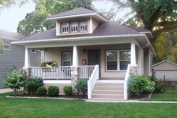 This 1924 Craftsman bungalow, was obscured by wide aluminum siding, a nondescript front porch, and misguided updates, until this couple brought back its period charm. See the transformation here. | thisoldhouse.com