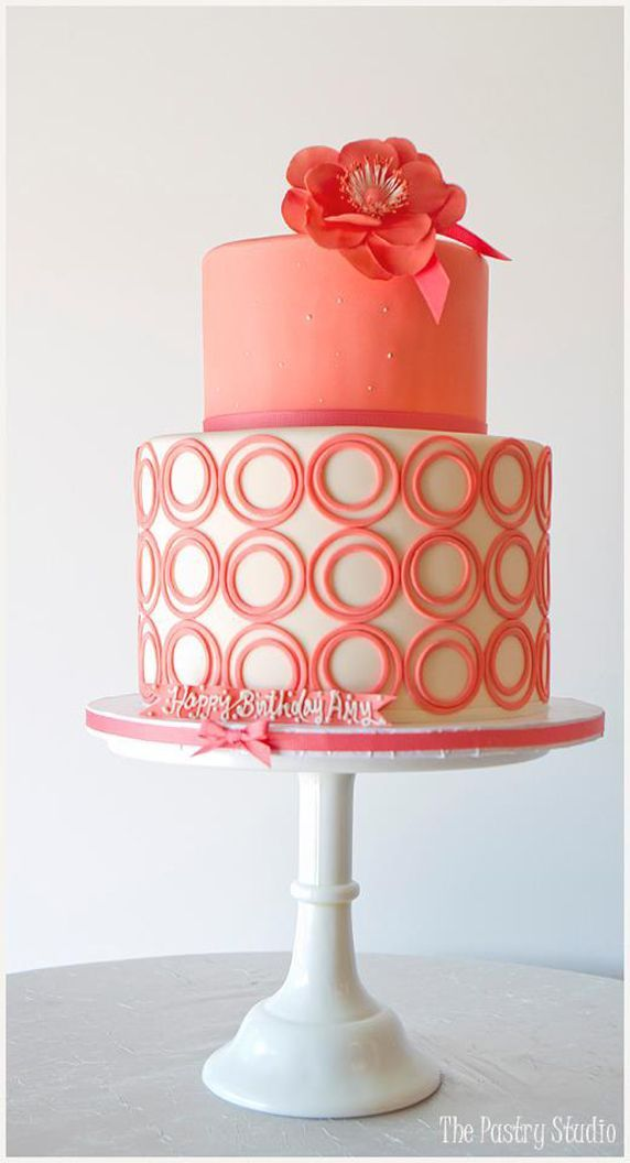 Coral-colored wedding cake with circles and bows #wedding #cake #weddingcake #coral #modern