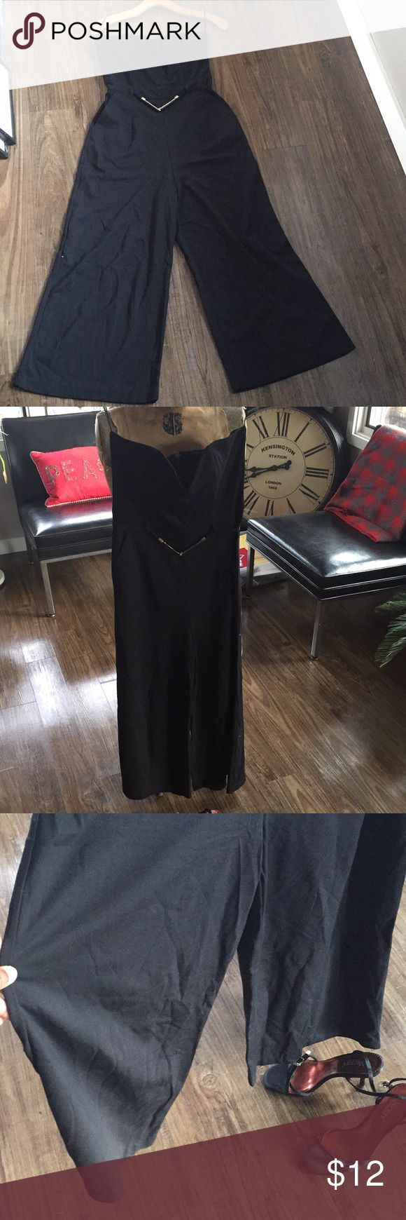 """Wide-leg, sleeveless jumper: Jump into 2018! Are you ready to ring in the New Year? I ring it in on my sofa, but I'm always dressed to celebrate me and what God has for me in the coming year. So, in the club or on the couch, this is the perfect  """"private party"""" jumper. Wide legs, ankle length. I'm a 6/8, 5""""5, model. I need more boobs for this one. Yours for a steal! Pants Jumpsuits & Rompers"""