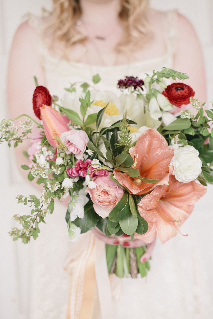 Fun Fact: The Foxglove Studio, the floral and event styling company that designed this gorgeous bouquet, is owned by the bride herself! Caitlin's rustic arrangement featured amaryllis, ranunculus, roses, coxcomb, and peonies. |   Photo by Stephanie Bassos Photography,   Flowers: The Foxglove Studio
