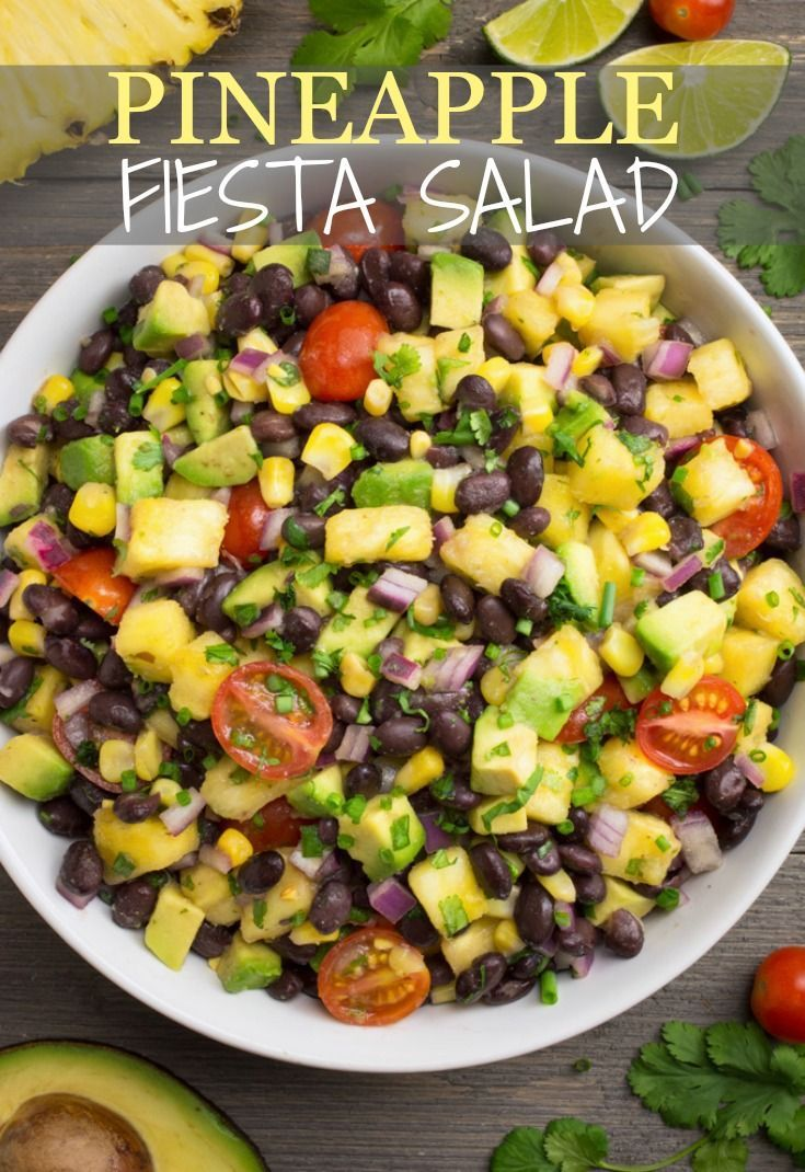 Pineapple Fiesta Salad is sure to be an instant favorite!  It's packed with sweet pineapple chunks, juicy tomatoes, diced avocado and protein packed black beans, then covered in a tangy lime dressing.  Serve this quick & easy Fiesta Salad as a dip, wrap or side and watch it disappear!  Great for parties, potlucks, picnics, meal prep and more!  #fiestasalad #blackbeansalad #pineapple #avocado #veganside #partyfood #veganrecipes #pineapplesalad #blackbeanrecipe #saladrecipe