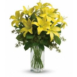 A fabulous bouquet of yellow asiatic lilies, salal and seeded eucalyptus are delivered in a divine bunch vase.