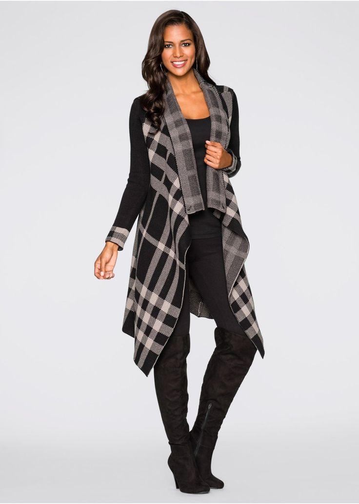 Stylově i během studeného ročního období! Pletený kabátek v délce ke kolenům s velkým kostkovaným vzorem. S řasením na límci. Délka ve vel. 36/38 cca 88 cm. Vrchový materiál: 100% akryl