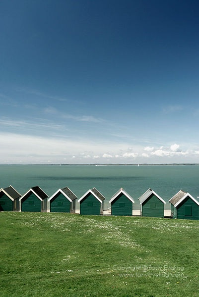 Beach huts on the seafront at Cowes, isle of Wight, Hampshire, UK