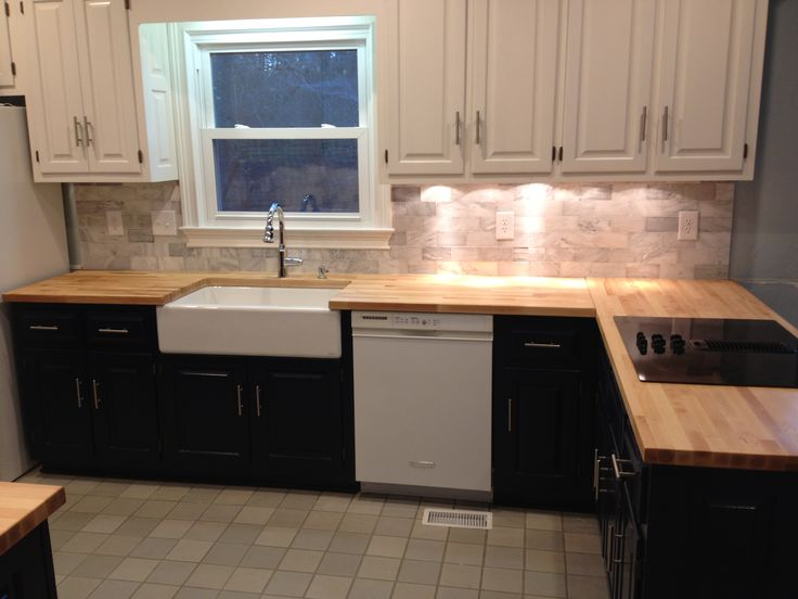 Kitchen remodel we used butcher block counter tops for Navy blue granite countertops