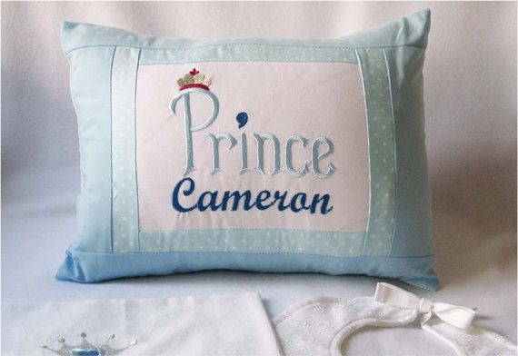 A delicate and cute pillow cover, the perfrct gift for a new born baby! This 100% cotton pillow is beautifully embroidered with the babys name , the word Prince and a silver crown. The back of the pillow is done in skyblue fabric. Envelope style sham opens in the back to allow for easy