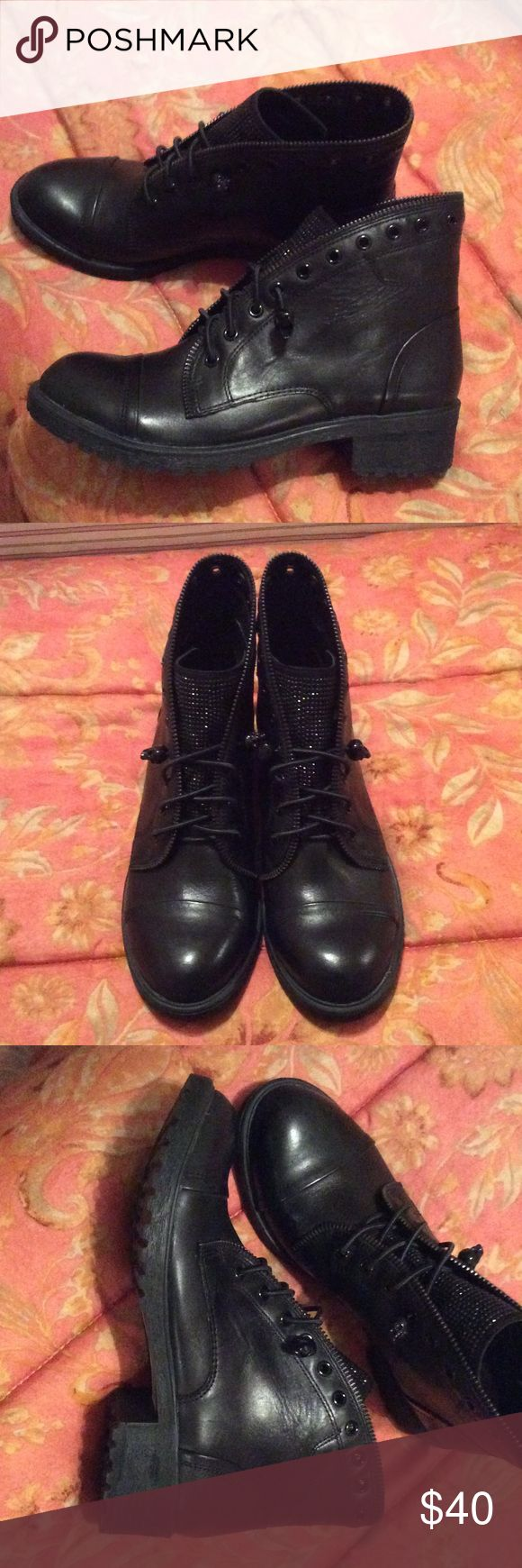 Gianni Bini GB women's Black booties size 5.5m Gianni Bini GB Women's black fire-worx lace-up booties size 5 1/2 m. Rubber bottom leather/fabric upper /fabric man made lining , Never worn tags attached. It did not come in a box Gianni Bini Shoes Ankle Boots & Booties