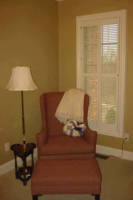 Lovely White Traditional Shutters In A Reading Nook.