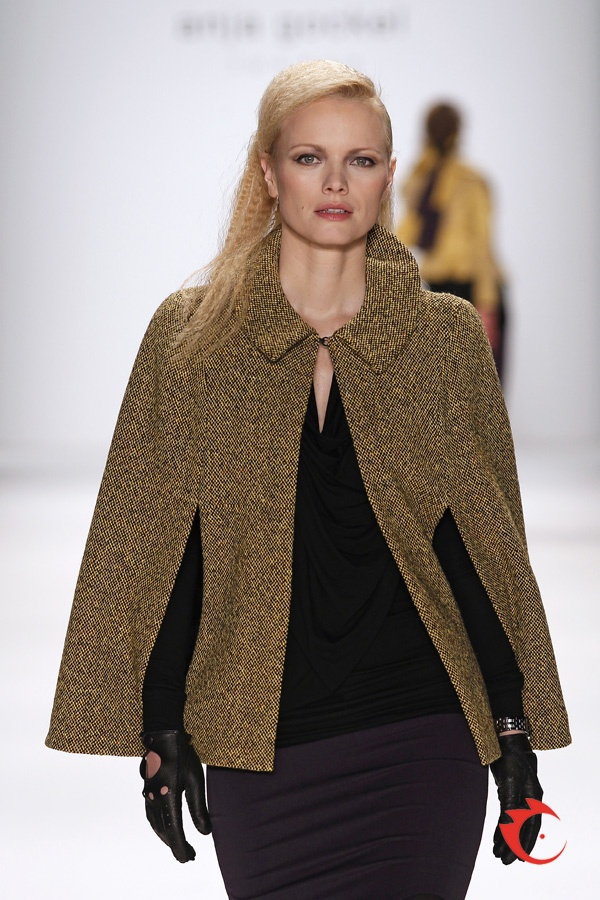 anja gockel - toffee colored tweed cape, comfortable black jersey top with waterfall neckline, miniskirt with wavy hem