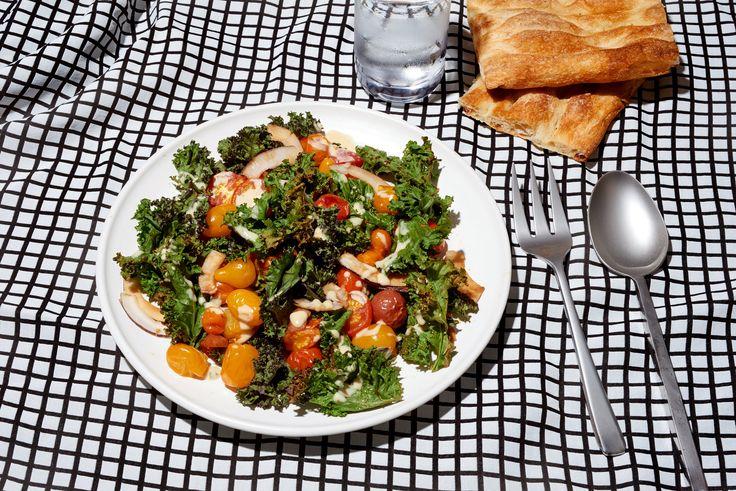 Warm kale, coconut and tomato salad