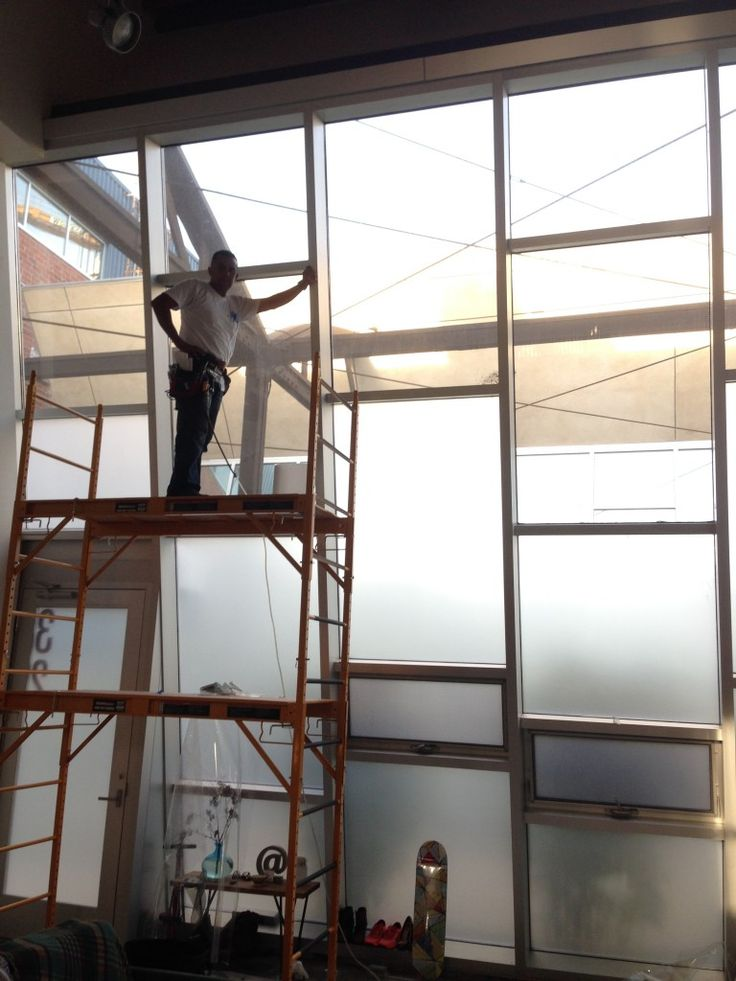 Frosted Window Film Being Applied To Commercial Office
