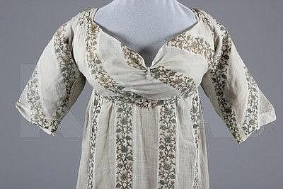 A printed muslin day dress, circa 1800-1810,  (Print is in stripes)