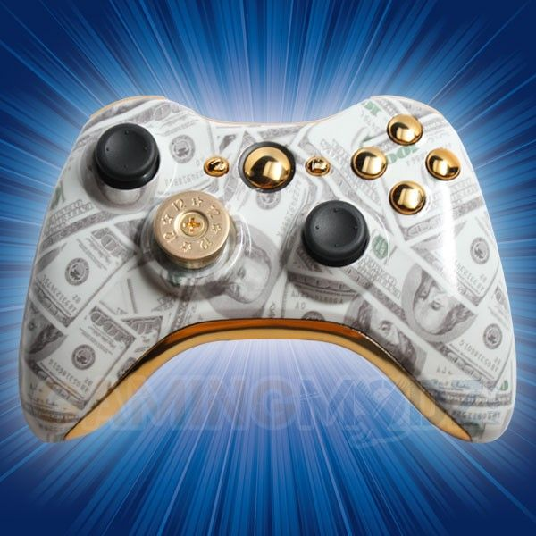 "Put your money where your mouth is with our new ""Money Talks"" Rapid Fire Modded Controller for Xbox 360. This controller features our custom ""Benjamins"" finish and includes gold inserts, gold buttons, bullet d-pad, and black thumbsticks. Available immediately exclusively from GamingModz.com ! Order today!"