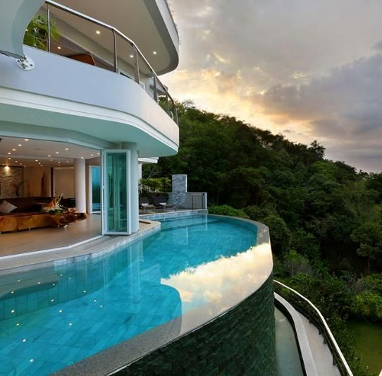 Luxurious Living: Mansion's Edgeless Pool | Part Inspiration Behind Vittoria Digital Luxury, the World's First Digital Luxury Provider. Exclusive Verifiable Luxury Wallpapers for iPhone® and iPad® at VittoriaDL.com.