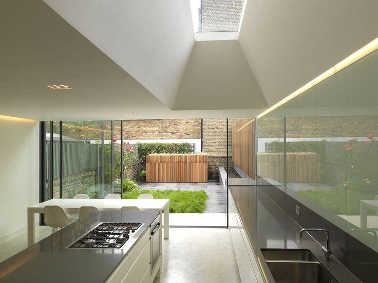 minimal windows sliding door and fixed frameless rooflight to rear extension in London www.iqglassuk.com