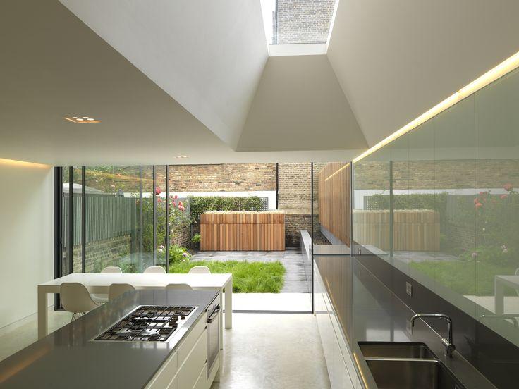 minimal windows sliding door and fixed frameless rooflight to rear extension in London www.iqglassuk.com
