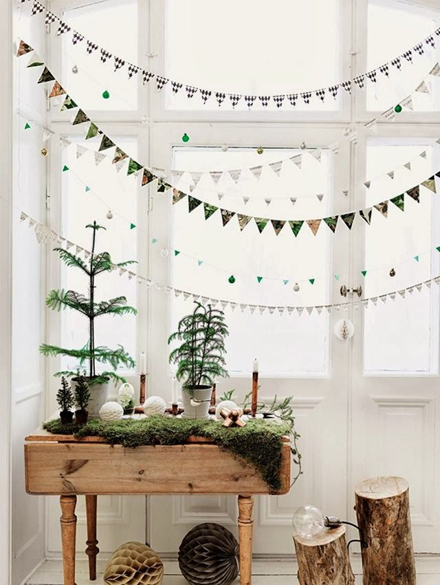 Christmas decorating with bunting banners, small trees, moss, etc.
