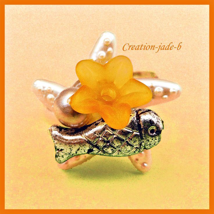 Bague Ajustable - Cabochon Etoile de mer avec Fleur orange