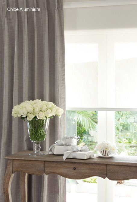 For a touch of elegance, choose Chloe with it's soft double pleat. We have teamed Chloe with a sunscreen roller blind featuring a flat bottom rail to complete this gracious look