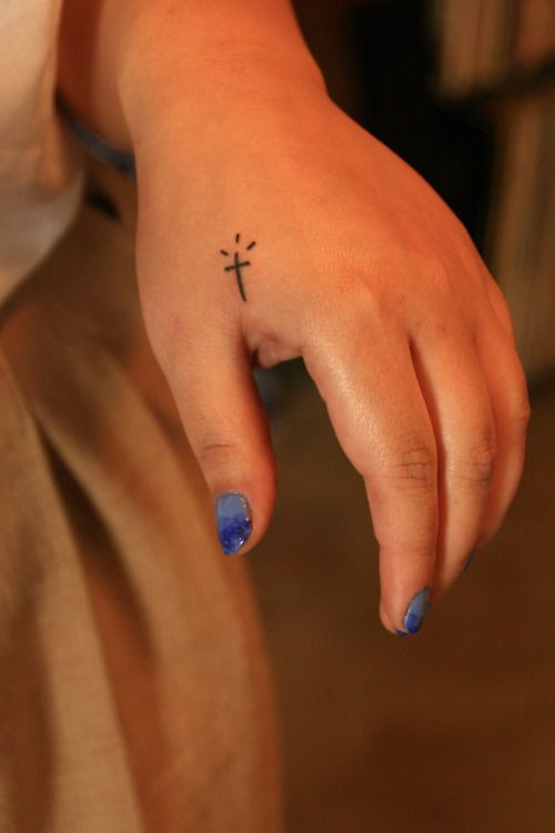 Small Cross Tattoo on the hand